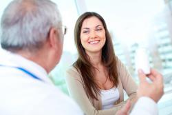 woman smiling with male doctor